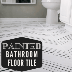Painted bathroom floor tile with a herringbone stencil